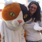 MickaCoo pigeon at SFACC adoptathon with person in cat suit