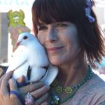 Rescued king pigeon Opal with RocketDog founder Pali