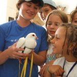Humane education campers meeting rescued king pigeon