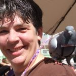 Blind pigeon Jenny with her adopter doing outreach