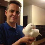 James rescued king pigeon Snow from the streets of San Francisco