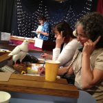 Volunteers & pigeons get on TV at KRCB's auction