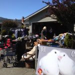 MickaCoo volunteers hosting a garage sale benefit