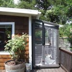 Cleverly designed aviary fits on deck next to house