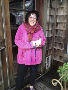 Laurie (with Olivia) at the cat door