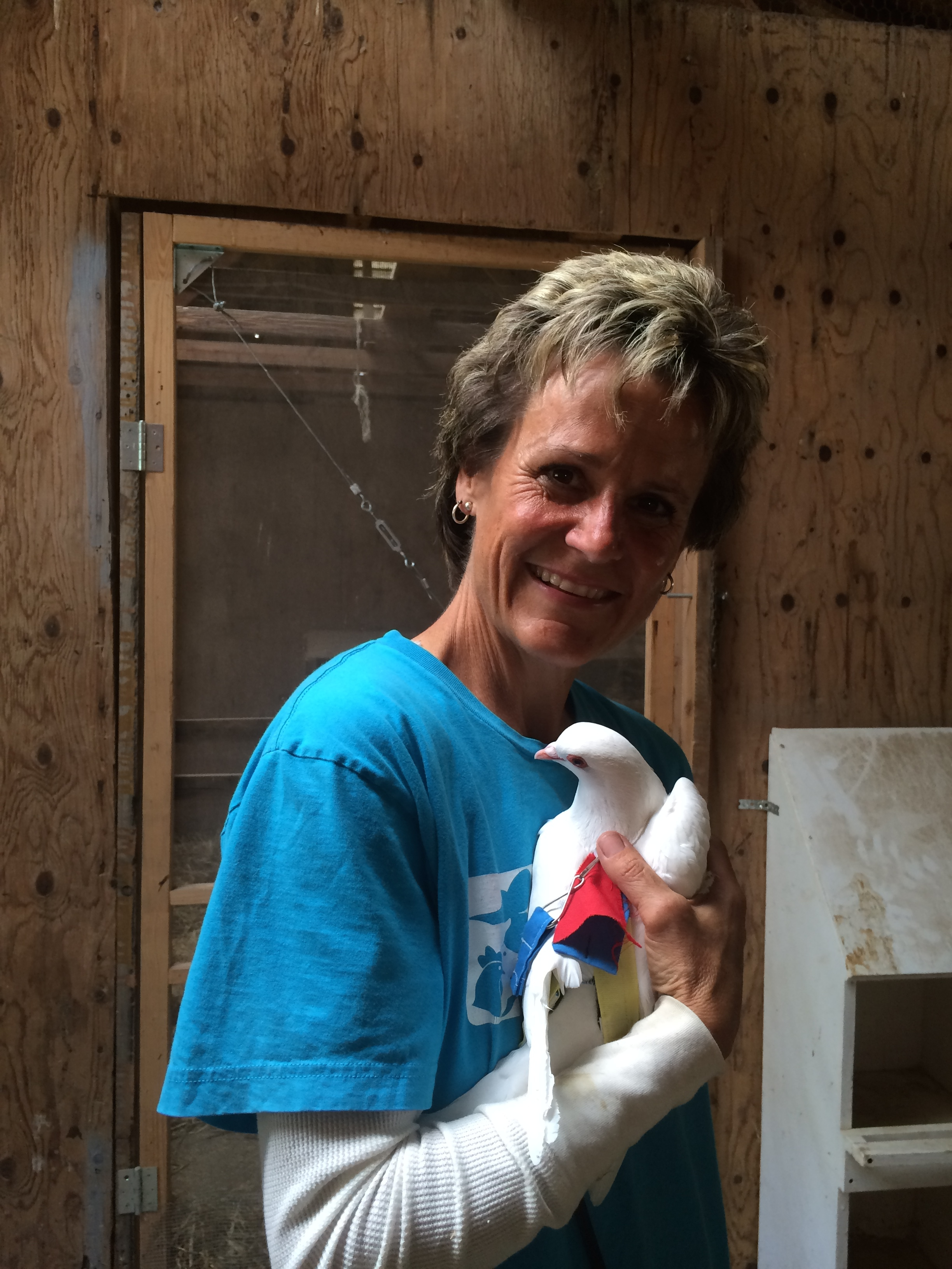Jan & Dylan (rescued King Pigeon). Jan cares for all of the animals at the Rescue Ranch