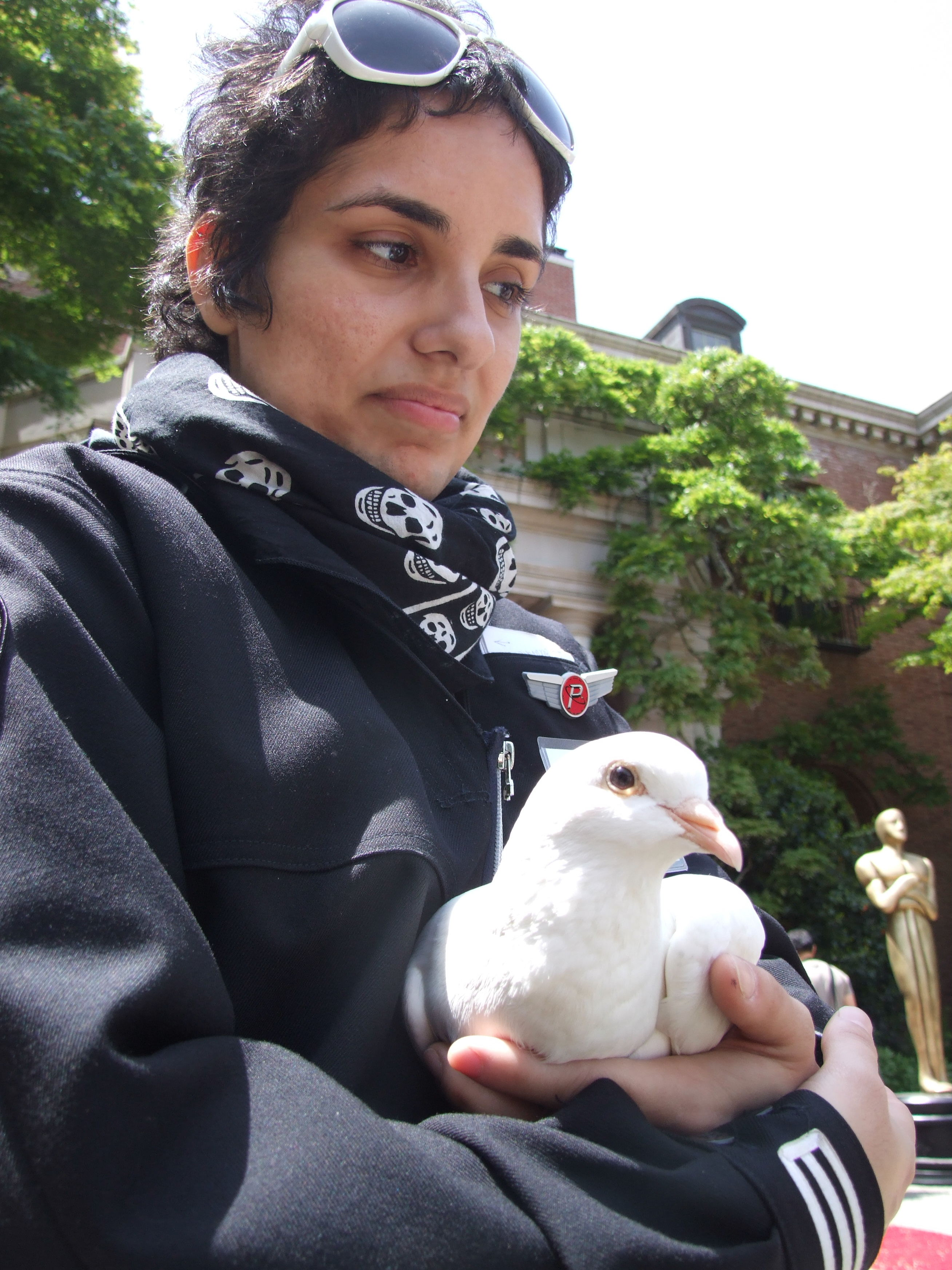 A woman and her pet pigeon
