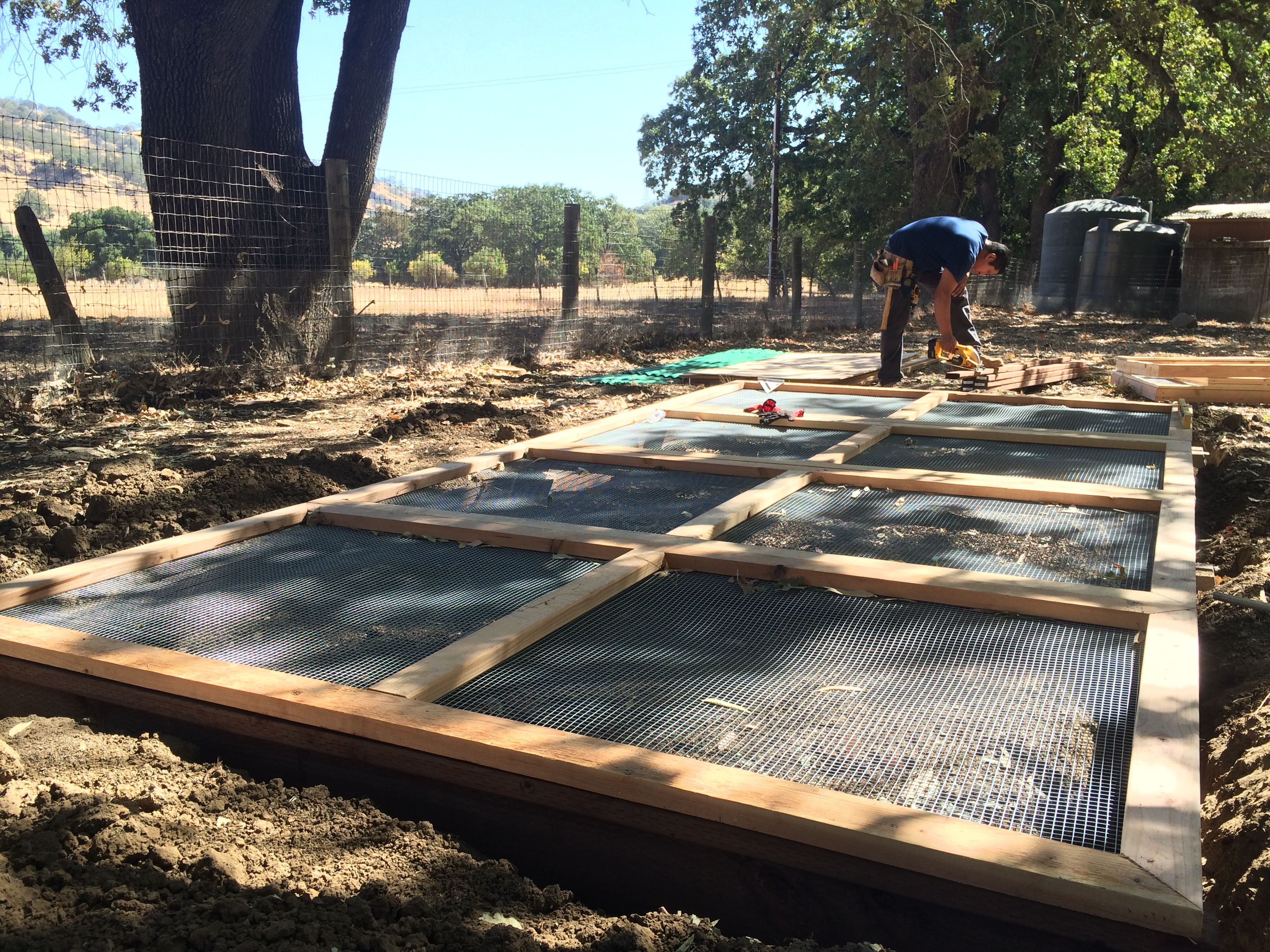 Predator & rodent-proof panels attached to treated lumber base