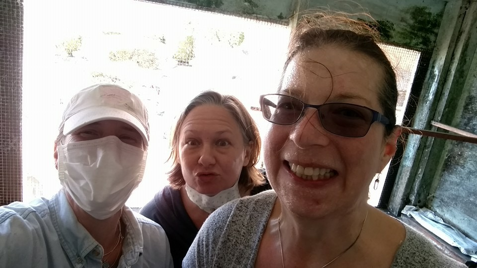 Selfie of 3 volunteers, sweaty & masked,
