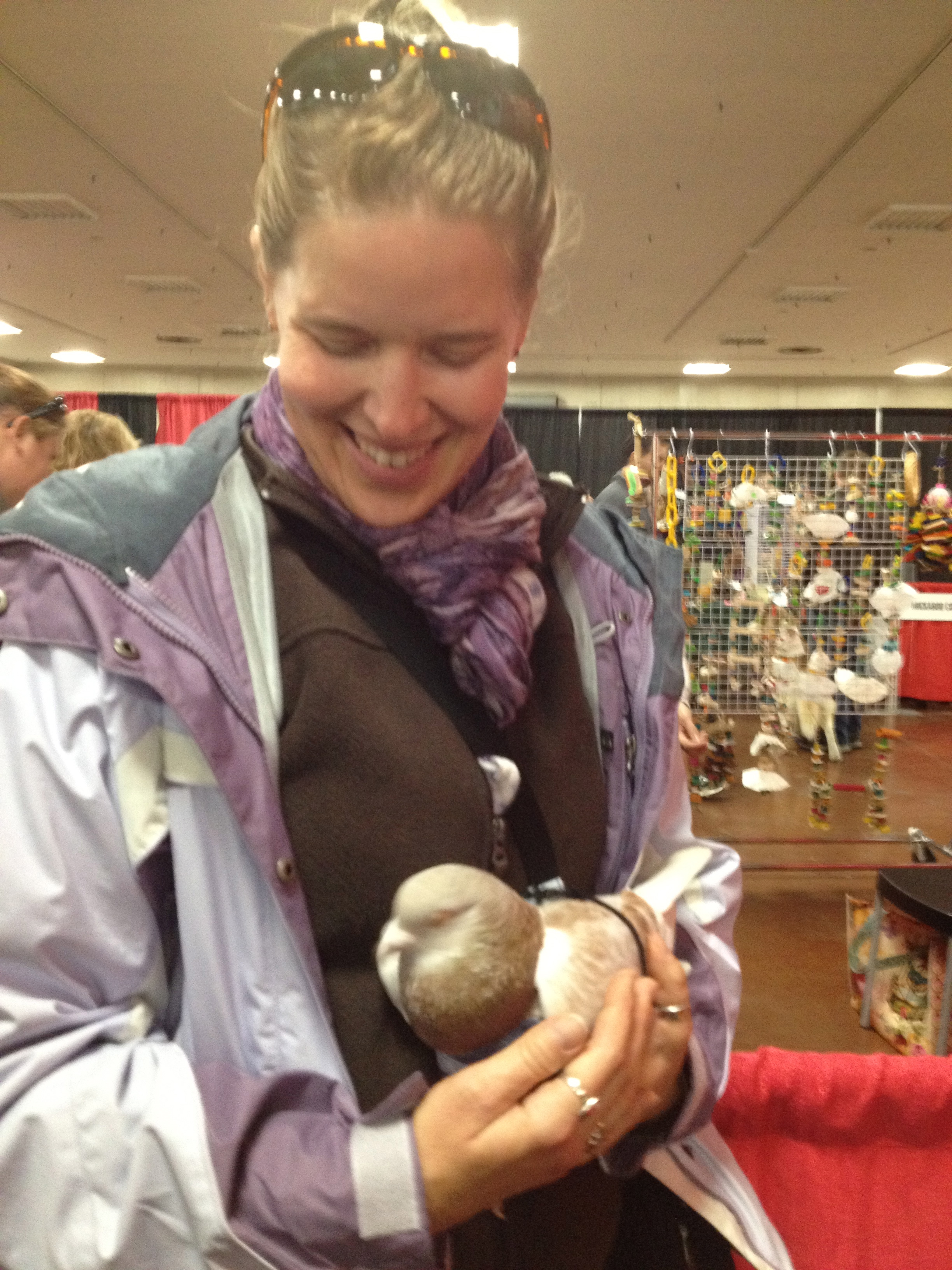 Liese holds a pigeon, Santino, for the first time